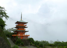 Beautiful Red Color Three-storied Pagoda in the Mist, Japan Royalty Free Stock Photography