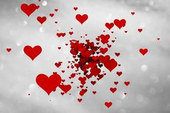Beautiful red colored hearts on silver background Stock Images