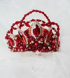 Beautiful red crown on a grey background stock images