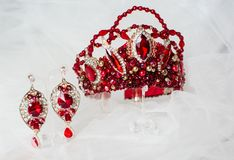 Beautiful red crown on a grey background royalty free stock photo