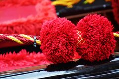 Beautiful red details of gondola, Venice, Italy. Beautiful red decorations and red background, details of a gondola in Venice, Italy, Europe Stock Photography