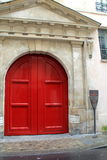 Beautiful red doors at entrance to Hotel Jean Bart, Paris,France,2016 Stock Photos