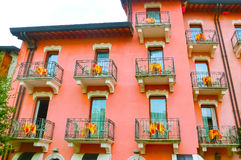 Beautiful red fasade of house at old town at Sirmione town, Italy. Royalty Free Stock Images