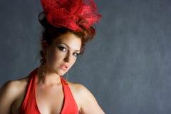 Beautiful red fashion model Stock Photography