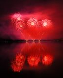 Beautiful red fireworks reflecting in water Royalty Free Stock Images