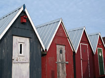 Beautiful red fishing huts on the coast Royalty Free Stock Photos