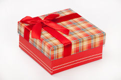 A beautiful red gift box with red bow Royalty Free Stock Photography