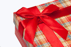 A beautiful red gift box with red bow.  Stock Photos
