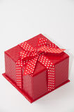 Beautiful red gift box with red bow. Red sausages and chicken with paprika ajvar Stock Images