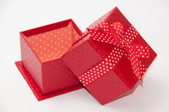 Beautiful red gift box with red bow. Red sausages and chicken with paprika ajvar Royalty Free Stock Photography