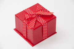 Beautiful red gift box with red bow Royalty Free Stock Photo