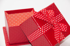 Beautiful red gift box with red bow Stock Photos