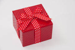 Beautiful red gift box with red bow. Red sausages and chicken with paprika ajvar Stock Image
