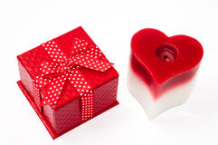 Beautiful red gift box wit red bow and heart candle Royalty Free Stock Photo