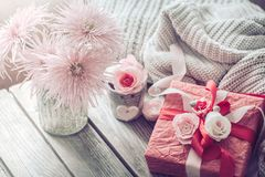 Beautiful red gift box on wooden background stock photo