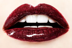 Beautiful red glossy lips Stock Photo