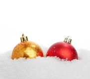 Beautiful red and gold Christmas ball in snow Royalty Free Stock Photography