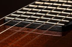 Beautiful red guitar and its parts.Guitar background.Guitar strings stock image