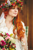 Beautiful red hair bride with flowers Royalty Free Stock Image