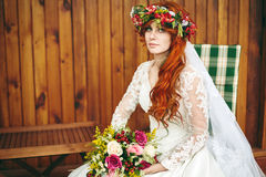 Beautiful red hair bride with flowers Stock Images