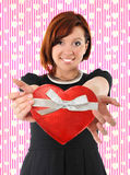 Beautiful red hair woman holding heart shape box anniversary box Stock Photos