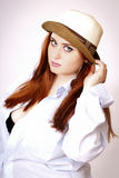 Beautiful red hair woman wearing hat Royalty Free Stock Images