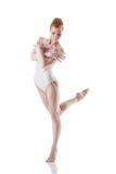 Beautiful red-haired ballerina dancing in studio Stock Photos