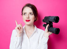 Beautiful red-haired businesswoman with binoculars Stock Photos