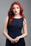 Beautiful red-haired fashion model posing in Stock Photo