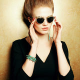 Beautiful red-haired fashion model in retro sunglasses Royalty Free Stock Photo