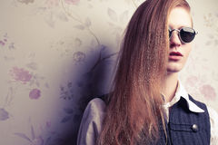 Beautiful red-haired fashion model in retro sunglasses Royalty Free Stock Photography