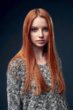 Beautiful red haired female in grey sweater Royalty Free Stock Photography