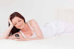 Beautiful red-haired female relaxing Stock Photos