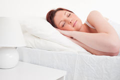 Beautiful red-haired female sleeping Stock Image