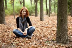 Beautiful red-haired girl in autumn park Royalty Free Stock Photos