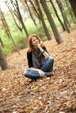 Beautiful red-haired girl in autumn park Stock Photo