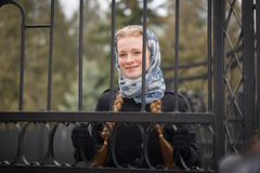 Beautiful red-haired girl behind forged fence Royalty Free Stock Photos