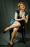Beautiful red-haired girl in a blue dress. Stock Photo