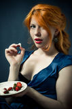 Beautiful red-haired girl in a blue dress. Royalty Free Stock Photos