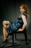 Beautiful red-haired girl in a blue dress. Royalty Free Stock Photography