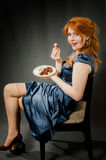 Beautiful red-haired girl in a blue dress. Stock Images