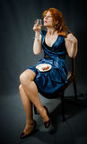 Beautiful red-haired girl in a blue dress. Stock Image