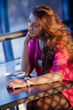 Beautiful red-haired girl in a cafe Stock Images