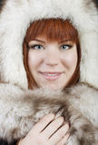 Beautiful red-haired girl in cap. Beautiful red-haired girl in a fur hat stock photos