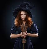 Beautiful red-haired girl in a  costume witch Royalty Free Stock Photos