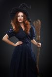 Beautiful red-haired girl in a  costume witch Royalty Free Stock Image