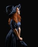 Beautiful red-haired girl in a  costume witch Stock Photos