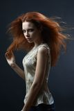 Beautiful red-haired girl in the dark Royalty Free Stock Photography