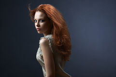 Beautiful red-haired girl in the dark royalty free stock image