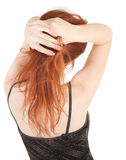 Beautiful red-haired girl in a dark evening dress Stock Photography